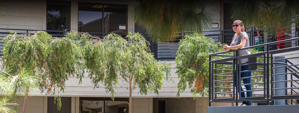 The Campus at Villa La Jolla woman standing in office building breezeway